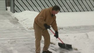 Neighbors help each other out after snowfall