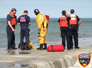 Three men swept away by Lake Michigan waves