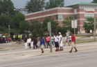 Protesters march in, around Mayfair Mall