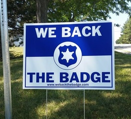 Injured officer given 'Back the Badge' sign