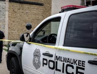 Man found dead in vehicle on city's north side
