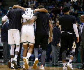 Bucks star Parker injured, helped off court