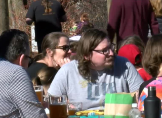 Residents enjoy record temperatures outdoors