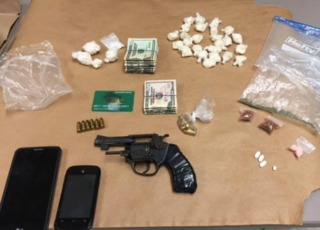 Illegal loaded gun, drugs found at Racine home