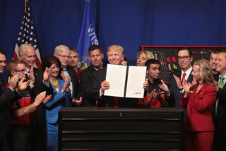 Trump signs executive order in Kenosha