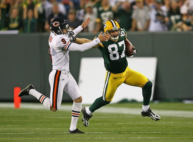 a2df32842 ... 2009 Jordy Nelson 87 of the Green Bay Packers fights off Robbie Gould 9  of the ...