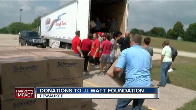 JJ Watt handing out supplies to flood victims on Sunday
