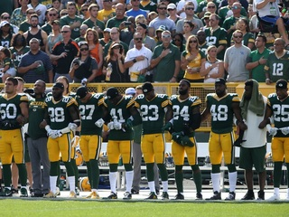 Local fans react to Packers players protest