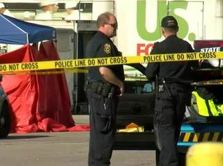 Man dies after becoming trapped between 2 cars