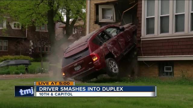 Jeep slams into house on Milwaukee's north side