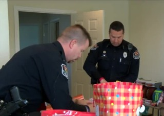 WI police bring holiday cheer with house party