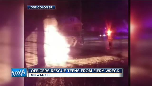CAUGHT ON CAMERA: Wisconsin police officers pull two people from burning vehicle