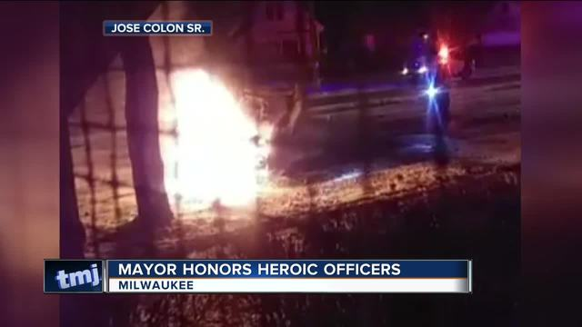 Milwaukee police officers rescue teens from burning vehicle  — DASH CAM