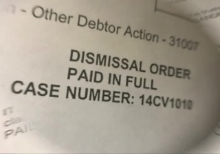 Woman penalized for debt, despite paying it off