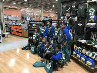 Giannis surprises kids with shopping spree