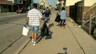 Volunteers clean procession route for officer