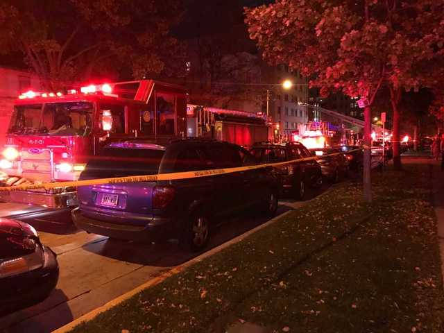 Reports of occupants trapped in apartment fire