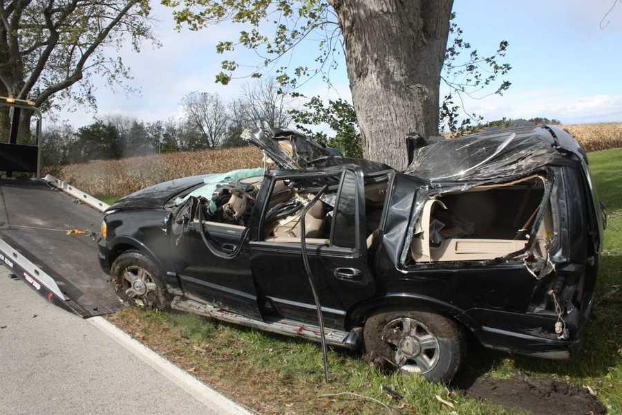 racine woman killed  husband injured after tree falls on car